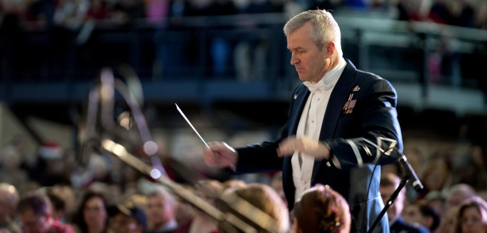 Stock photo of an older white man conducting a military orchestra