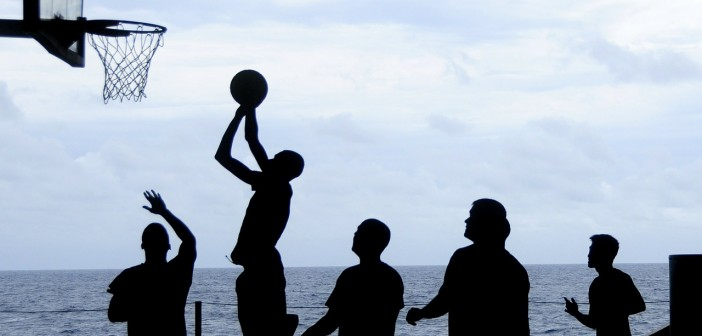 Stock photo of a group of silhouettes playing basketball