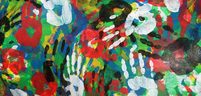Stock photo of a mural of multi-colored hand prints
