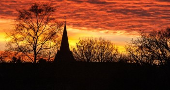 Stock photo of a silhouette of a church in a sunset