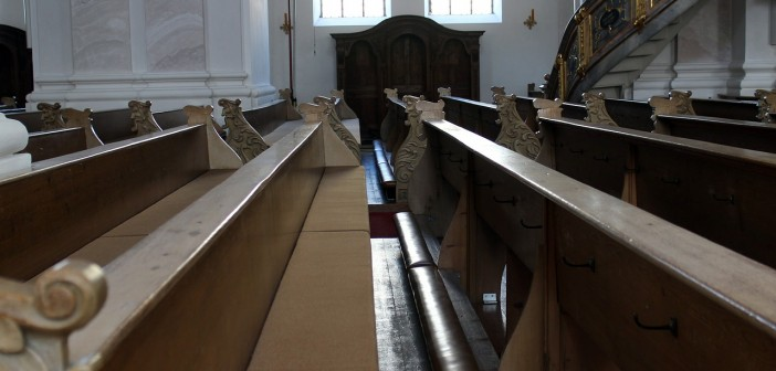 Stock photo of an empty pew