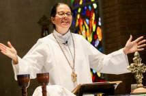 Stock photo of a woman presiding over communion