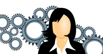 Clip art of a woman with a bunch of gears behind her