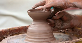 Stock photo of someone crafting something on a potter's wheel
