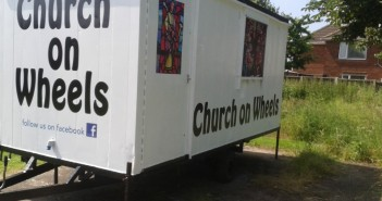 "Stock image of a trailer that says ""Church on Wheels"""