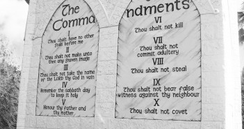 Stock photo of the Ten Commandments engraved into a stone wall