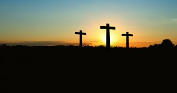 Stock photo of three crosses on a hill
