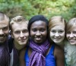 Stock photo of a diverse group of young people posing for a portrait