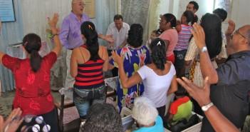 Stock photo of a Latino/a house church worship service