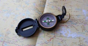 Stock photo of a field compass laying on top of a map