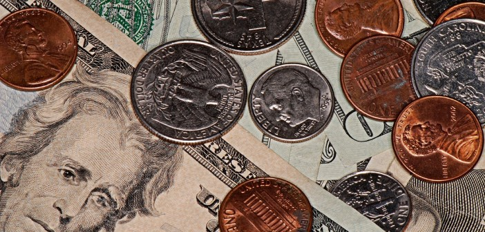 Stock photo of a pile of money in assorted bills and coins