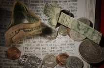 Photo of money lying atop a Bible