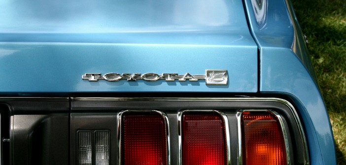 Stock photo of a closeup of the rear-passenger side of a sky-blue Toyota