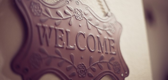 Stock photo of a wrought iron welcome sign