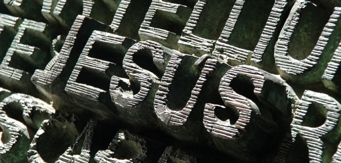"Stock photo of the word ""JESUS"" carved out of stone"