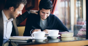 Stock photo of two young men at a coffee shop