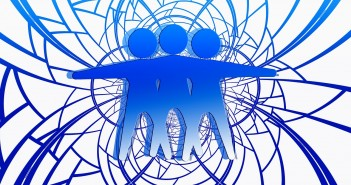 Clip art of three androgynous individuals embracing each other amidst an abstract representation of conflict