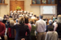Stock photo of a group of people worshipping together