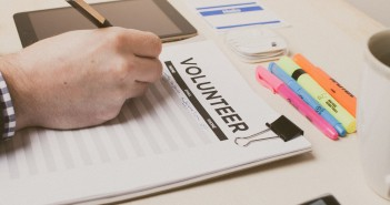 Stock photo of someone signing up to volunteer