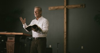 Stock art of an older white man preaching