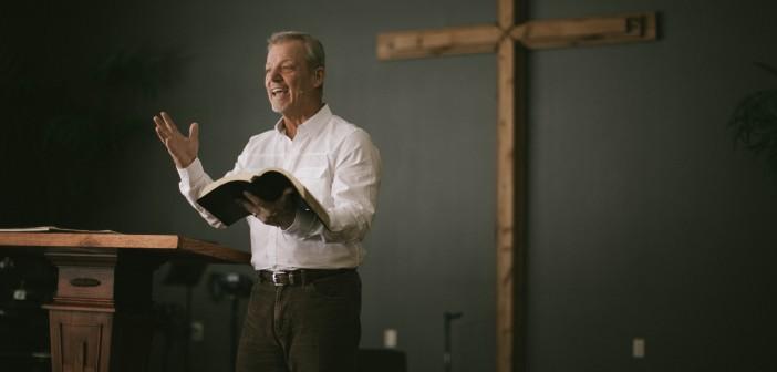 Stock art of an older white man preaching