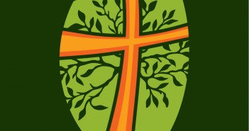 Clip art of an orange cross with green leaves coming out from it