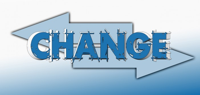 Clip art of the word CHANGE with two arrows pointing in opposite directions behind it
