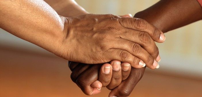 Stock photo of three African American hands on top of each other