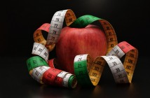 Photo of an apple draped with a measuring tape