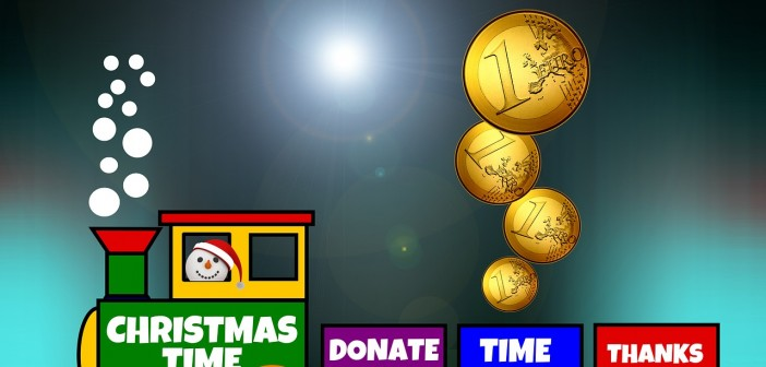 "Clip art of a toy train. The front engine is green and conducted by a snowman wearing santa hat and says ""Christmas Time"". The second car is purple and says ""Donate"". The third car is blue and says ""Time"" and it has four coins being dropped into it. The last car is read and says ""Thanks"""