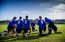 Stock photo of a group of young male soccer players in a huddle