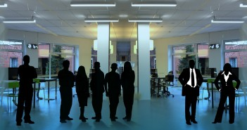 Stock photo of a group of silhouettes in a room