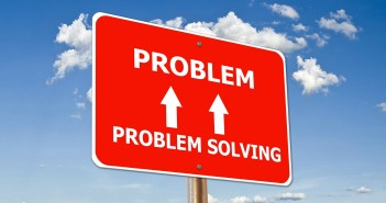 "Stock photo of a road sign that has ""PROBLEM SOLVING"" with two arrows pointing up to ""PROBLEM"""