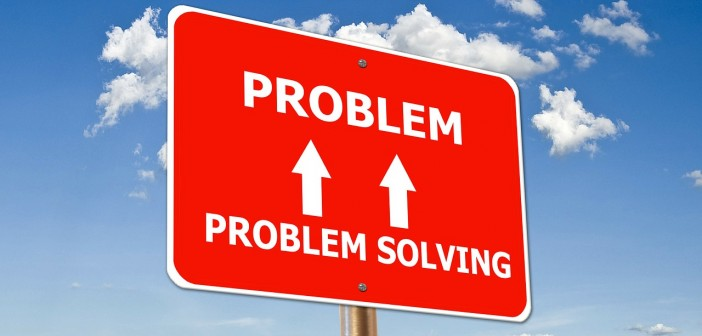 """Stock photo of a road sign that has """"PROBLEM SOLVING"""" with two arrows pointing up to """"PROBLEM"""""""
