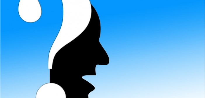 Clip art of a silhouette profile and a question mark
