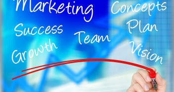 "Stock photo of a hand writing ""MARKETING"" ""CONCEPTS"" ""SUCCESS"" ""TEAM"" ""PLAN"" ""GROWTH"" and ""VISION"" on a whiteboard"
