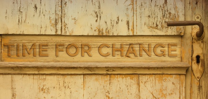 "Stock photo of a door with the words ""TIME FOR CHANGE"" carved into it"