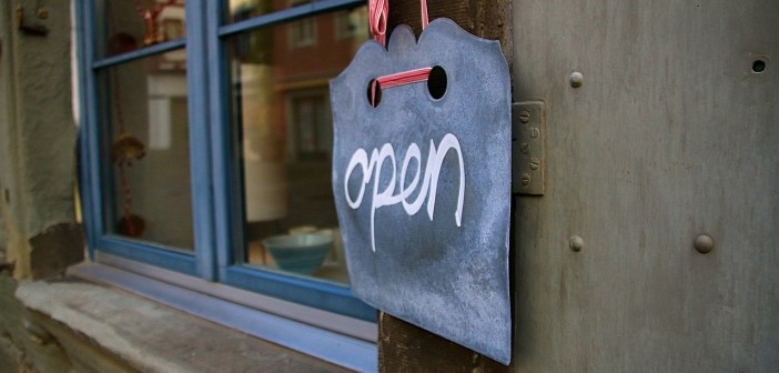 "Stock photo of a chalk sign that says ""open"" in a cursive script"