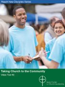 Taking Church to the Community Video Tool Kit cover showing a smiling group of people collecting signatures on a clipboard
