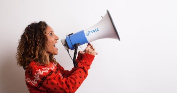 Photo of a woman shouting into a megaphone