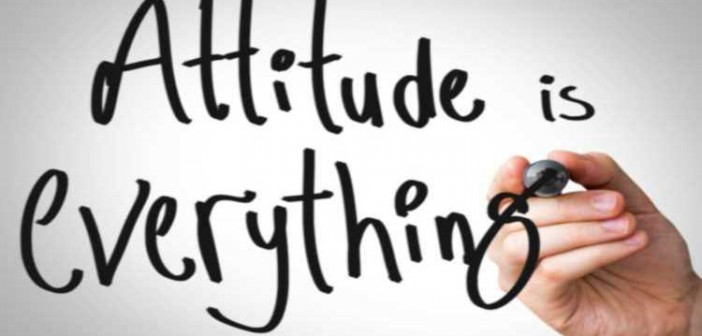 """Stock photo of someone writing """"Attitude is everything"""" on a whiteboard"""
