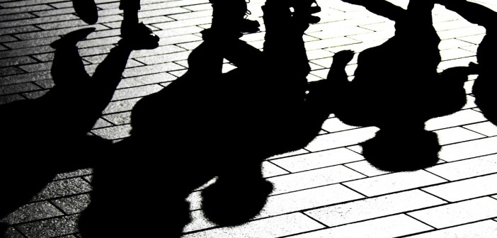 Stock photo of a bunch of shadows on a brick street