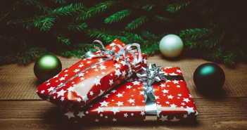 Stock photo of two wrapped Christmas presents under a tree