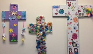 Stock image of three whimsical crosses, as if decorated by children