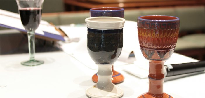 Photo of several cups to be used in a communion service