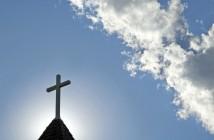Photo of church steeple against a blue sky