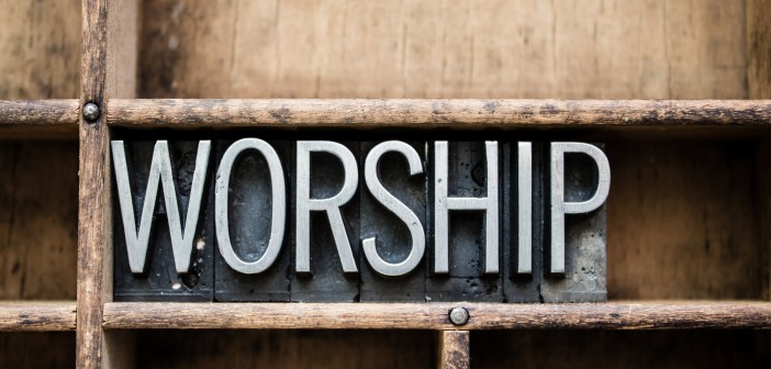 "The word ""WORSHIP"" written in vintage metal letterpress type"