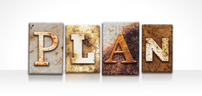 """The word """"PLAN"""" written in rusty metal letterpress type"""