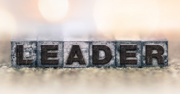 The word leader spelled out in typeset lettering