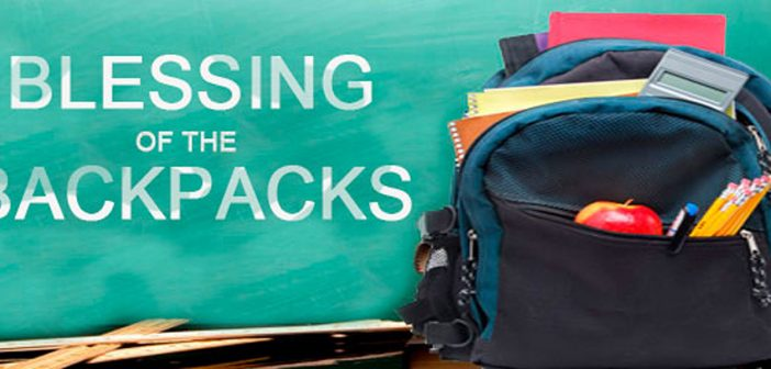 Photo of child's backpack with school supplies and the words Blessing of the Backpacks